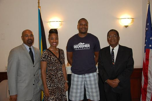 Photo: WASHINGTON, D.C. -- Mr. Andrew Russell, a Bahamian who currently lives in Dallas, Texas, paid a courtesy call on His Excellency Dr. Eugene Newry, Bahamas Ambassador to the United States, at the Embassy of the Bahamas, 2220 Massachusetts Avenue, N.W., on Monday, July 7, 2014. Mr. Russell, who graduated from Nassau Christian Academy, went to college in Chattanooga, Tennessee, and is presently a student at Redeemer Seminary in Dallas. He is in Washington, D.C., for a month looking at a potential job opportunity at Grace D.C. Presbyterian Church after he completes his seminary studies. Pictured from left to right are Mr. Chet Neymour, Deputy Chief of Mission, Embassy of The Bahamas; Miss Krissy Hanna, Second Secretary, Embassy of The Bahamas; Mr. Russell; and Ambassador Newry.