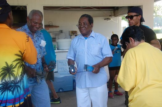 Photo: JUNKANOO DIPLOMACY? -- His Excellency Dr. Eugene Newry (right), Bahamas Ambassador to the United States, joined in a Junkanoo Rush Out at the picnic hosted by the Bahamian-American Association on Saturday, July 12, at the U.S. Coast Guard Base, 7323 Telegraph Road, Alexandria, from 1:00 p.m. to 7:00 p.m. At left is Mr. Bernard Colebrooke, a Bahamian who is a retired U.S. Marine and one of the leaders of the Bahamian-American Association. The picnic was one of the events held over the weekend to celebrate the 41st anniversary of The Bahamas' attainment of independence. An official independence anniversary reception was held at the St. Regis Hotel, 923 16th and K Streets, N.W., in downtown Washington on Friday, July 11, and an independence church service was held on Sunday, July 13, at the African Methodist Episcopal Church (AME), 1518 M Street, N.W., Washington, D.C., at which the Bahamas National Youth Choir was the featured choir.
