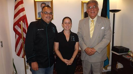 "Photo: NEW YORK -- Chef Tim Tibbetts, Executive Chef and Owner of Flying Fish Restaurant in Freeport, Grand Bahama,  along with his wife, Mrs. Rebecca Tibbetts, Co-owner and General Manager Flying Fish Restaurant, paid a courtesy call on the Hon. Forrester J. Carroll, Bahamas Consul General to New York, on Friday, July 11, 2014, at Bahamas House, 231 East 46th Street. The restaurateurs were on a brief tour of New York making stops at the James Beard House, showing their talents at the ""Sustainable Seafood Celebration"" and Food and Wine Magazine. The AAA 4 Diamond Award winning team is making waves in the culinary world. Pictured from left to right are Chef Tibbetts, Mrs. Tibbetts and Consul General Carroll."